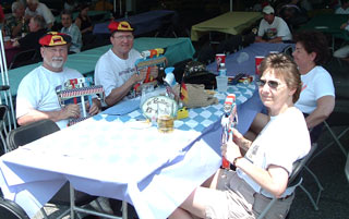 Springfest visitors with their wooden clappers